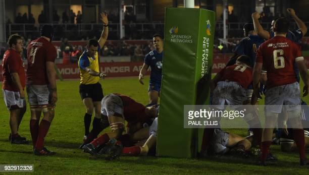 France's hooker Guillaume Marchand scores his team's third try during the Under20 Six Nations international rugby union match between between Wales...
