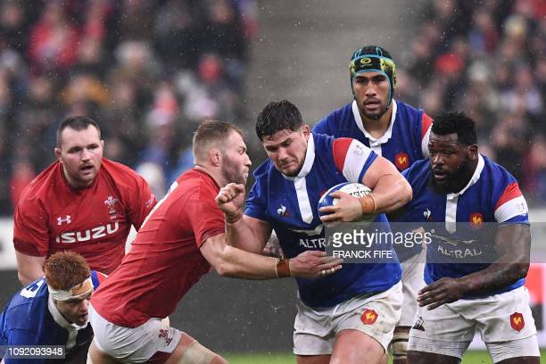 France's hooker Julien Marchand is tackled during the Six Nations rugby union tournament match between France and Wales at the stade de France in...