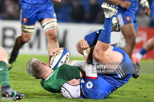 France's hooker Maxime Lamothe tackles Ireland's centre David McCarthy during the Six Nations U20 rugby union match between France and Ireland at the...