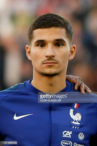 France's Houssem Aouar listens to the national anthem before the friendly under21 football match between Germany and France in Essen western Germany...