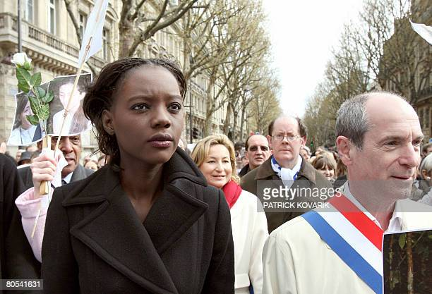 France's Human Rights deputy Minister Rama Yade takes part in a solidarity marche with several thousands of people on April 6 2008 in Paris to call...