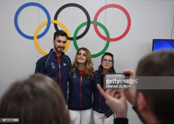 France's ice dance silver medallists Gabriella Papadakis and Guillaume Cizeron pose for a picture with France's freestyle skiing halfpipe silver...