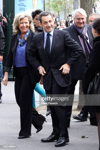 France's incumbent President and rightwing ruling party Union for a Popular Movement candidate Nicolas Sarkozy arrives at a polling station to cast...