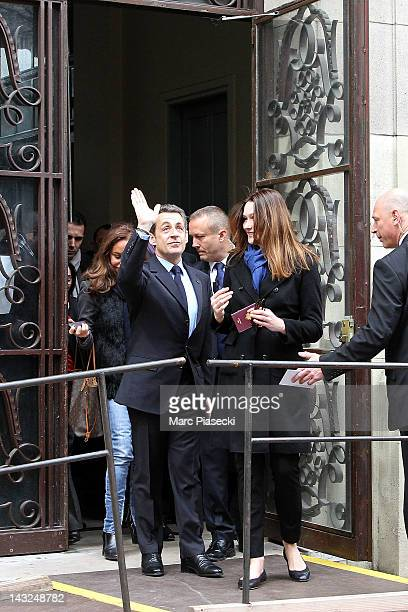 France's incumbent President and rightwing ruling party Union for a Popular Movement candidate Nicolas Sarkozy and his wife Carla BruniSarkozy leave...