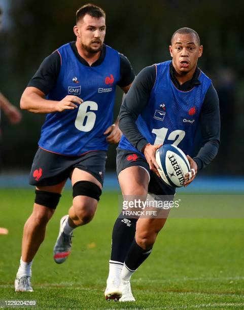 France's inside centre Gael Fickou runs with a ball during a training session on October 21 2020 in Marcoussis south of Paris as part of the...