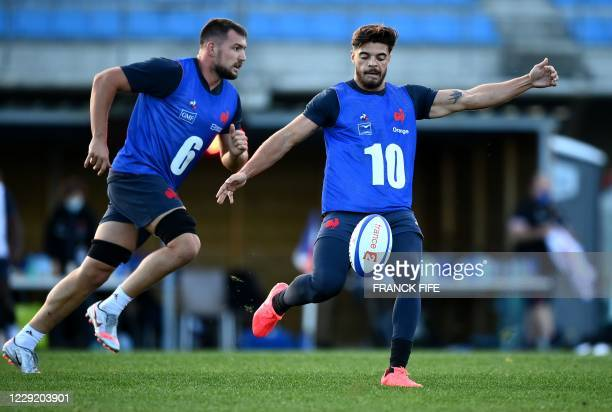 France's inside centre Romain Ntamack kicks the ball during a training session on October 21 2020 in Marcoussis south of Paris as part of the...