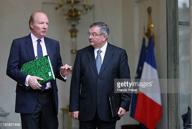 France's Interior Minister Brice Hortefeux chats with Justice Minister Michel Mercier as they leave the weekly cabinet meeting at Elysee Palace on...