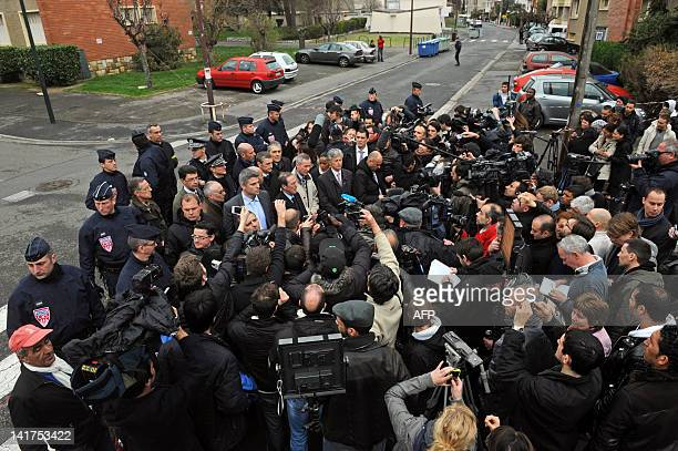 France's Interior minister Claude Gueant speaks to journalists flanked by prosecutor François Molins on March 22 2012 in Toulouse southwestern France...