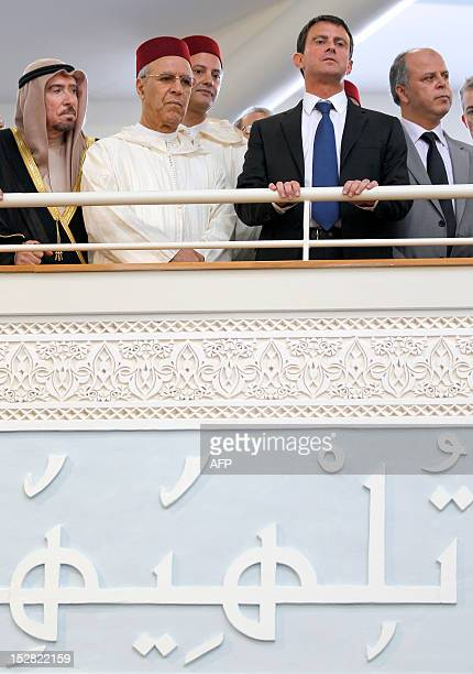 France's Interior Minister Manuel Valls and Morocco's Minister of Endowments and Islamic Affairs Ahmed Toufiq attend with other guests the official...