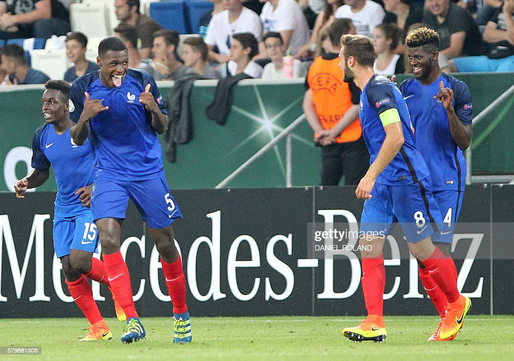 France's Issa Diop (2L) celebrates scoring the 4-0 during the Under 19 Football European Championships final match France vs Italy in Sinsheim, southern Germany, on July 24, 2016. / AFP / DANIEL