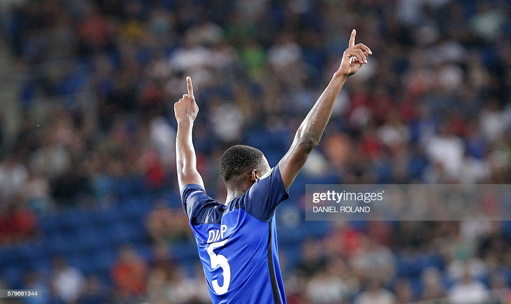 France's Issa Diop celebrates scoring the 4-0 during the Under 19 Football European Championships final match France vs Italy in Sinsheim, southern Germany, on July 24, 2016. / AFP / DANIEL