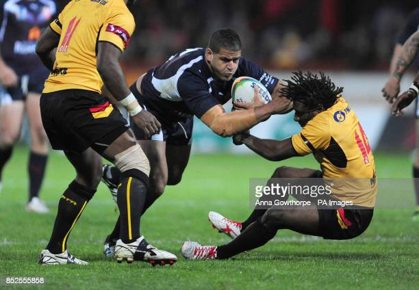 France's Jamal Fakie and Papua New Guinea's Charlie Wabo in action during the 2013 World Cup match at Craven Park, Hull.