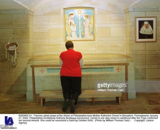 Frances Jarvis prays at the shrine of Philadelphia born Mother Katherine Drexel in Bensalem Pennsylvania January 27 2000 Philadelphia Archbishop...