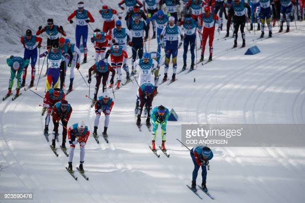 France's Jean Marc Gaillard competes during the men's 50km cross country mass start classic at the Alpensia cross country ski centre during the...