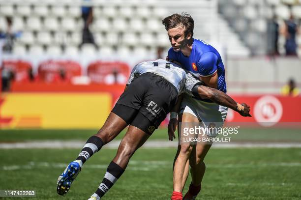 France's Jean Pascal Barraque is being tackled during the HSBC World Rugby Sevens Series rugby quarter finals match between Fiji and France, at the...