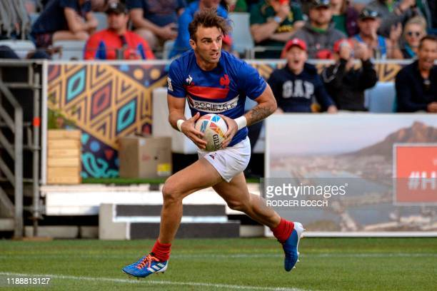 France's Jean Pascal Barraque scores a try during the HSBC World Rugby Sevens Series men's bronze final rugby match between France and Fiji at the...