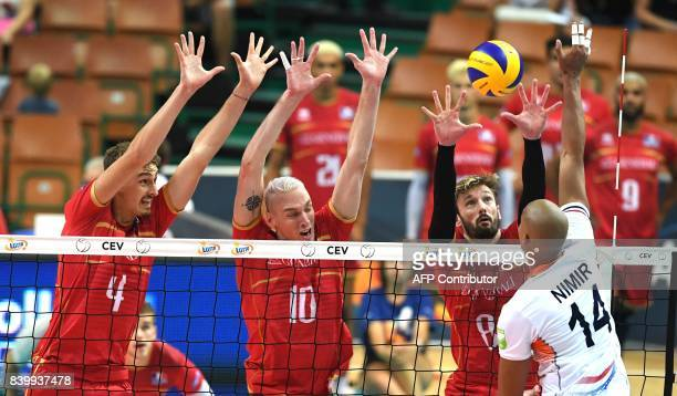 France's Jean Patry Kevin le Roux and Julien Lyneel block the ball against AbdelAziz Nimir of Netherlands during the group D match between France and...