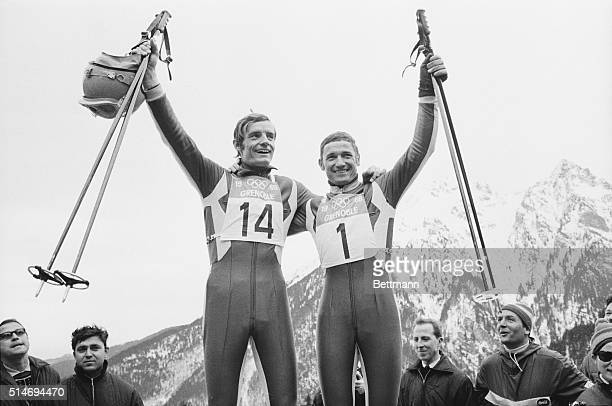 France's Jean-Claude Killy and Guy Perillat celebrate their performances in the men's downhill ski event at the 1968 Winter Olympics in Grenoble....