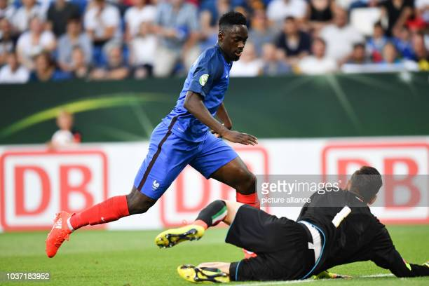 France's JeanKevin Augustin  scores the 10 goal past Italy's goalkeeper Alex Meret during the UEFA European Under19 Championship final soccer match...