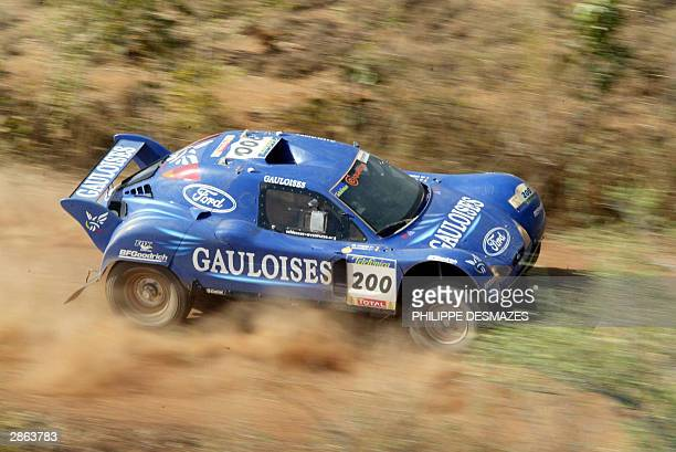 France's JeanLouis Schlesser flanked by his teammate JeanMarie Lurquin steers his Schlesser Ford during the 12th stage of the 26th edition of the...