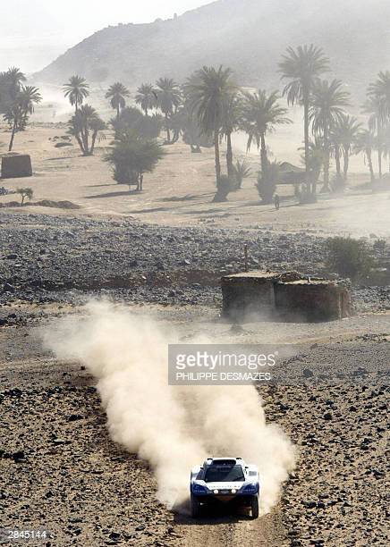 France's JeanLouis Schlesser on Schlesser FORD creates a dust trail as he steers his car during the 5th stage of the 26th Dakar rally raid between Er...