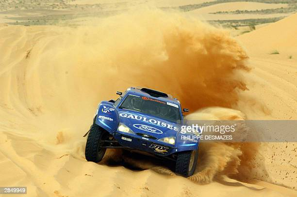 France's Jeanlouis Schlesser steers his Schlesser Ford during the 7th stage of the 26th edition of the Dakar rally raid between TanTan in Morocco and...