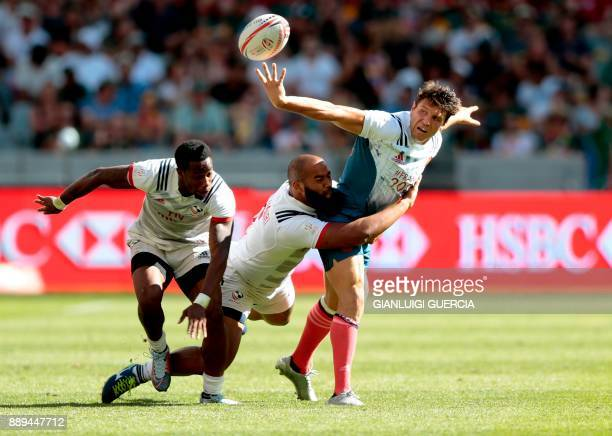 TOPSHOT France's Jeremy Aicardi is tackled by Malon Aljibori of the US during their match on the second day of the World Rugby Sevens Series at Cape...