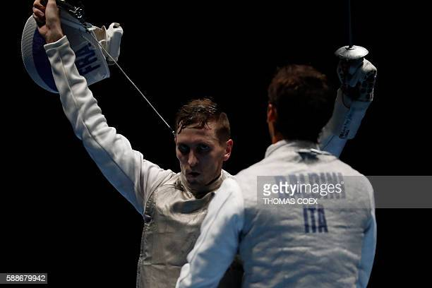 France's Jeremy Cadot reacts next to Italy's Andrea Baldini during the mens team foil semifinal bout between Italy and France as part of the fencing...