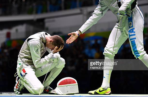 TOPSHOT France's Jeremy Cadot reacts to losing against Italy's Andrea Cassara in their mens individual foil qualifying bout as part of the fencing...