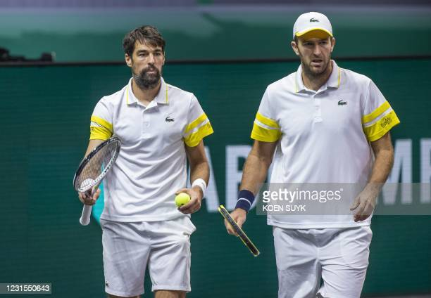 France's Jeremy Chardy and Fabrice Martin are seen during their Rotterdam ATP tournament men's double semi-final tennis match against Croatia's...