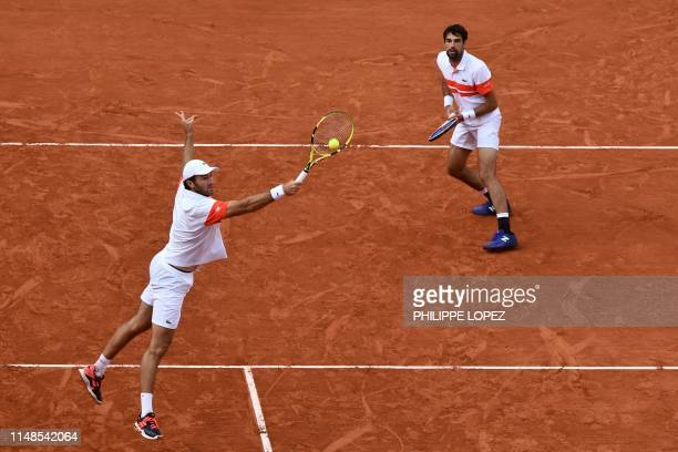 France's Jeremy Chardy and France's Fabrice Martin return the ball to Germany's Kevin Krawietz and Germany's Andreas Mies during their men's doubles...