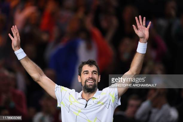 France's Jeremy Chardy celebrates after winning against Russia's Daniil Medvedev during their men's singles tennis match on day two of the ATP World...