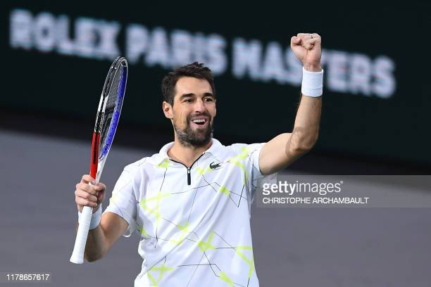 France's Jeremy Chardy celebrates winning against USA's Sam Querrey during their men's singles tennis match on day one of the ATP World Tour Masters...