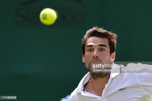 France's Jeremy Chardy eyes the ball as he returns against US player Ryan Harrison during their men's first round match on day two of the 2013...