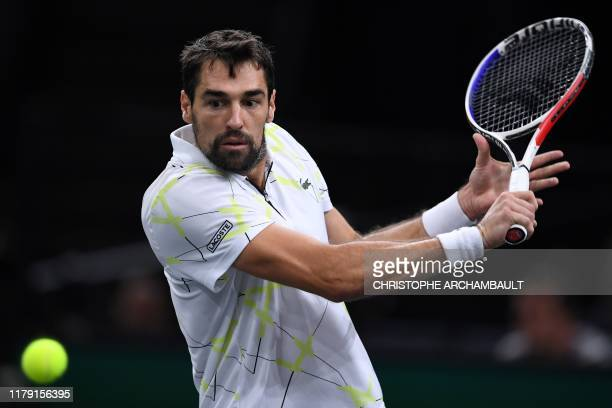 France's Jeremy Chardy eyes the ball as he returns the ball to Chile's Christian Garin during their men's singles tennis match on day four of the ATP...