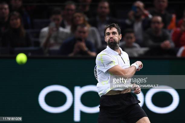 TOPSHOT France's Jeremy Chardy eyes the ball as he returns the ball to Chile's Christian Garin during their men's singles tennis match on day four of...