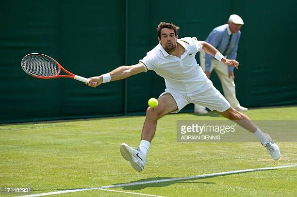France's Jeremy Chardy reaches for a return against US player Ryan Harrison during their men's first round match on day two of the 2013 Wimbledon...