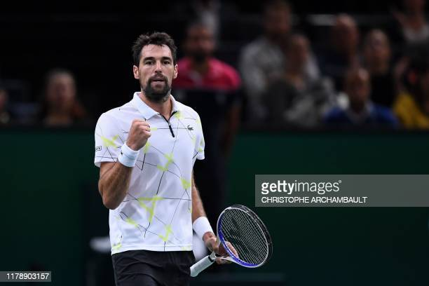 France's Jeremy Chardy reacts after winning a point against Russia's Daniil Medvedev during their men's singles tennis match on day two of the ATP...