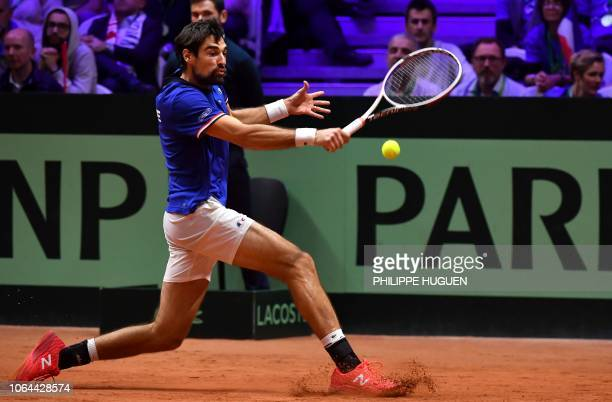 France's Jeremy Chardy returns a ball to Croatia's Borna Coric during the opening single tennis match as part of the Davis Cup final between France...