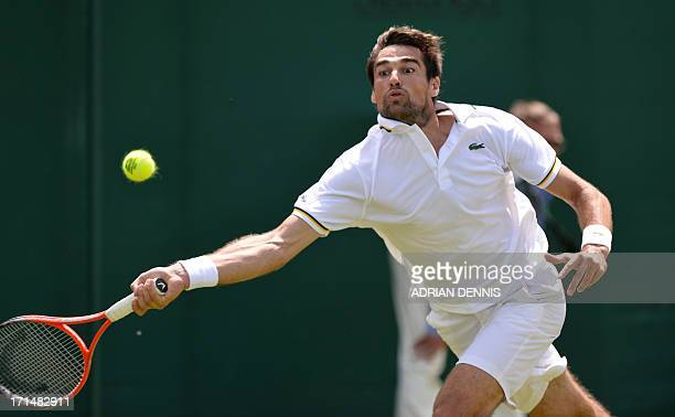 France's Jeremy Chardy returns against US player Ryan Harrison during their men's first round match on day two of the 2013 Wimbledon Championships...