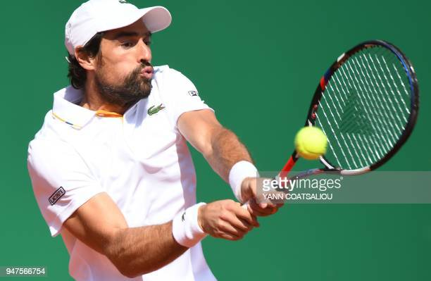 France's Jeremy Chardy returns the ball to France's Richard Gasquet during their tennis match at the Monte-Carlo ATP Masters Series Tournament, on...