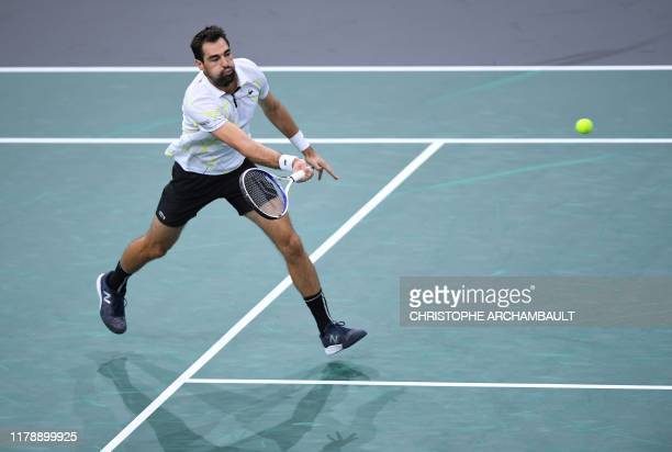 France's Jeremy Chardy returns the ball to Russia's Daniil Medvedev during their men's singles tennis match on day two of the ATP World Tour Masters...