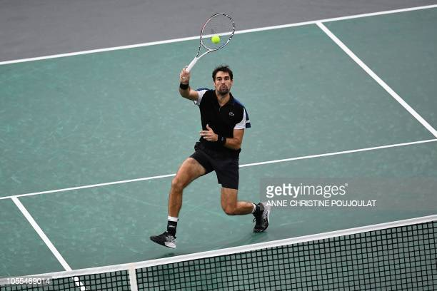 France's Jeremy Chardy returns the ball to Spain's Fernando Verdasco during their men's singles first round match on day two of the ATP World Tour...