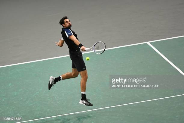 TOPSHOT France's Jeremy Chardy returns the ball to Spain's Fernando Verdasco during their men's singles first round match on day two of the ATP World...