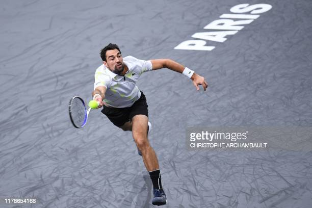 France's Jeremy Chardy returns the ball to USA's Sam Querrey during their men's singles tennis match on day one of the ATP World Tour Masters 1000...