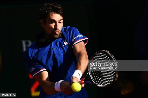 France's Jeremy Chardy returns to Italy's Fabio Fognini during the Davis Cup quarter final Italy versus France on April 6 2018 at the 'Valletta...