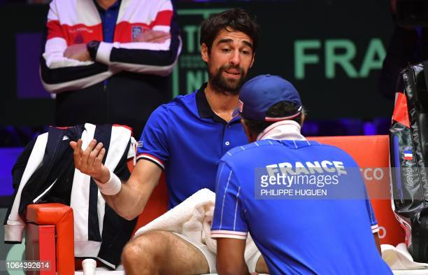 TOPSHOT France's Jeremy Chardy speaks with the team captain during the opening single tennis match against Croatia's Borna Coric as part of the Davis...