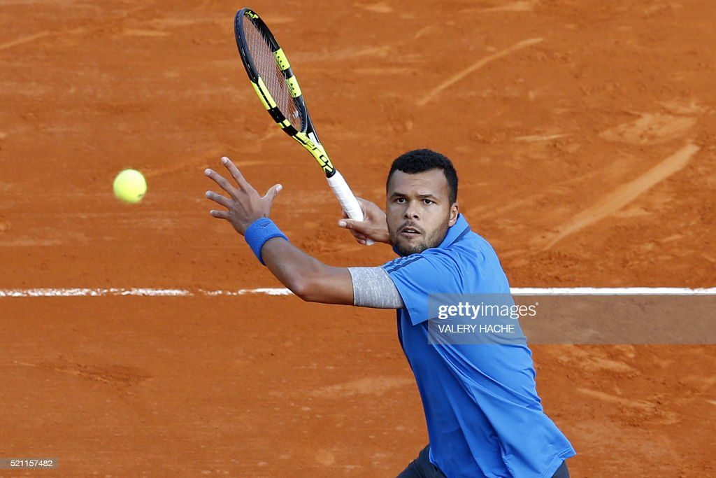 France's Jo Wilfried Tsonga returns the ball to France's Lucas Pouille during their tennis match at the Monte-Carlo ATP Masters Series tournament on April 14, 2016 in Monaco.