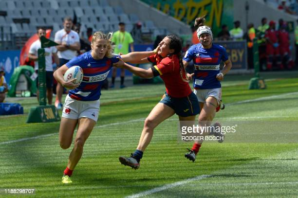 TOPSHOT France's Joanna Grisez fends off a Spanish player during the HSBC World Rugby Sevens Series women's rugby match between France and Spain at...