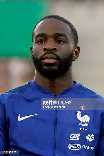 France's Jonathan Ikone listens to the national anthem before the friendly under21 football match between Germany and France in Essen western Germany...